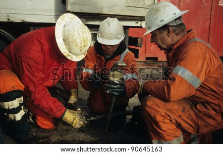SEXBIERUM, THE NETHERLANDS, CA NOVEMBER 2008 : Rig-personnel in the salt-mining industry being occupied with wireline-tools in Sexbierum, the Netherlands on November 2008
