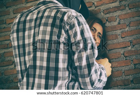 Sexual abuse with a terrorist attacking a scared female in abandon building. Rape and Sexual abuse concept.dark tone #620747801
