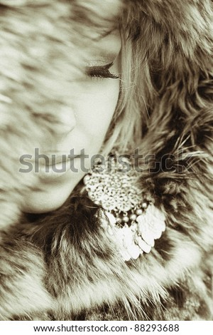 sexual beautiful girl wrapped in a warm fur. Special effect film grain. Small depth of sharpness - stock photo