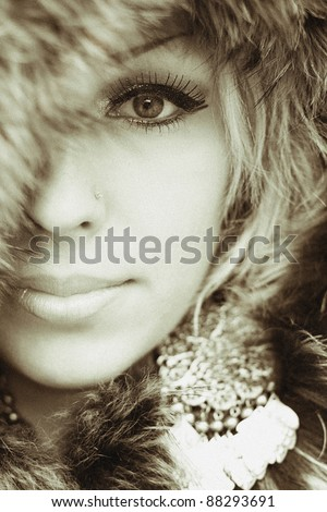 sexual beautiful girl wrapped in a warm fur. Special effect film grain. Small depth of sharpness