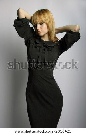 Sexual blonde with black clothes. Fashion photo.