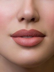 Sexual full lips. Natural gloss of lips and woman's skin. The mouth is closed. Increase in lips, cosmetology. Natural lips. Great summer mood with open eyes. fashion jewelry. Pink lip gloss