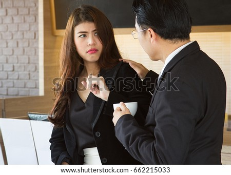 Sexual harassment at work concepts. Boss / manager molesting female employee in workplace. Female is disgusting face. #662215033