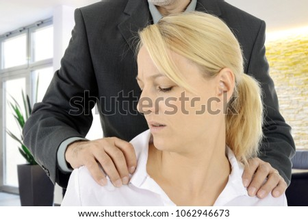 Sexual harassment of a woman by a man, colleague or boss at work in the office #1062946673