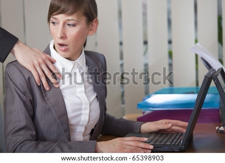 sexual harassment - surprised woman looking at the hand on her shoulder