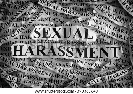 Sexual harassment. Torn pieces of paper with the words sexual harassment. Concept Image. Black and White. Closeup. #390387649