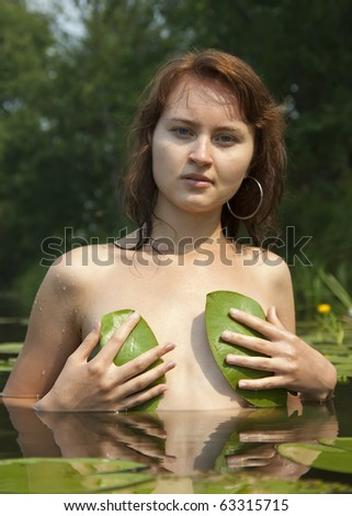 stock photo : Sexual nude girl posing topless against river