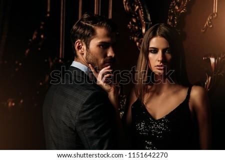 Sexual passionate couple in elegant evening dresses. Luxurious interior. Fashion shot. #1151642270