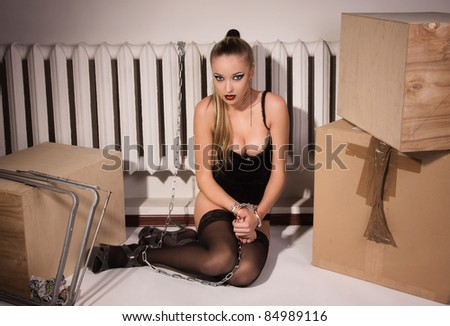 Sexual slavery. Young woman in the chains