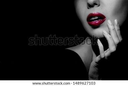 Sexual woman with red lips on black background with copy space. Black white photo. Model fashion advertising image. Sensuality. Sexuality. Femme Fatale mysterious portrait. Professional makeup.