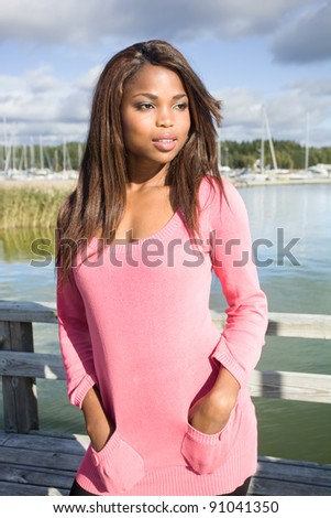 Sexy african american woman posing on a pier