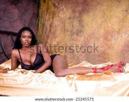 stock photo Sexy African American woman with very large breasts looking