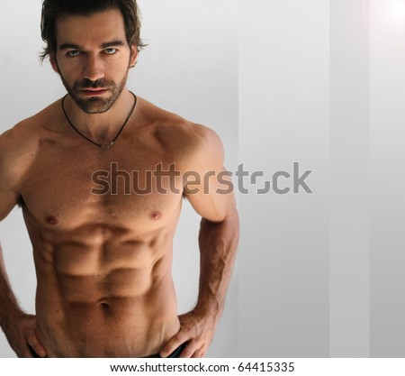 Sexy athletic shirtless man against neutral background