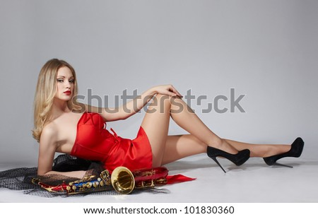 Sexy attractive women with saxophone