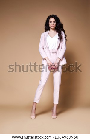 52489c5646e89 Sexy beautiful business woman lady boss CEO manager makeup long curly hair  brunette wear clothes office