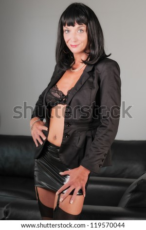 sexy beautiful business woman standing in the office