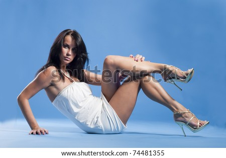 Sexy beautiful lady sitting on a floor
