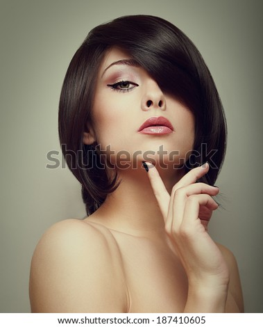 Sexy beautiful makeup woman with hand under face. Closeup vintage portrait