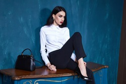 Sexy beautiful woman dark brunette hair wear clothes pants jacket trend accessory makeup perfect body model fashion office style businesswoman natural beauty casual silk texture elegant design formal.