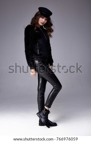 Sexy beautiful woman skinny body shape wear black bomber blouse lather pants shoes accessory hat luxury clothes glamour model beauty salon brunette hair fashion style party cosmetic makeup trend.
