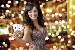Sexy beautiful young girl in casino (background bokeh)