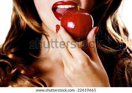 Sexy beautiful young pretty woman / model / girl / student / businesswoman / secretary with red lips, vintage / retro is eating an apple / lips / seductive - closeup