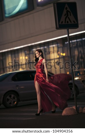 Sexy beauty woman in fluttering red dress - motion shot - stock photo