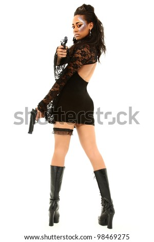 Sexy Black Female In Black Dress And Boots Aiming A Handgun At The Camera