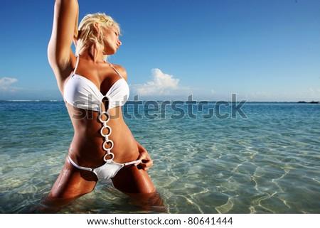 Sexy blond model in a white bikini #80641444