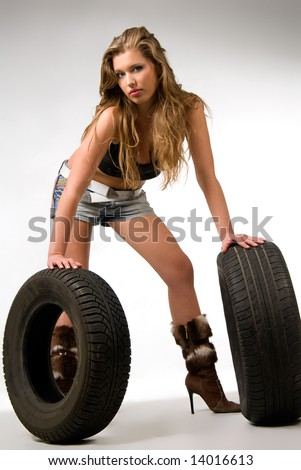 Sexy blond with two wheels over white