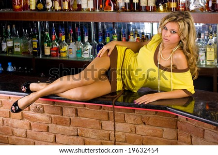Sexy blond woman in a bar