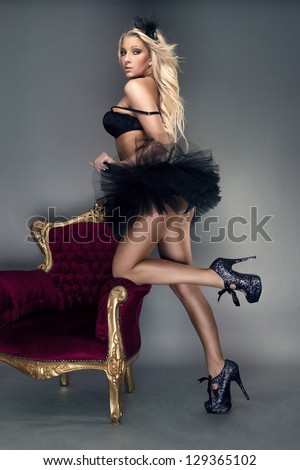 Sexy blond woman in black skirt - stock photo