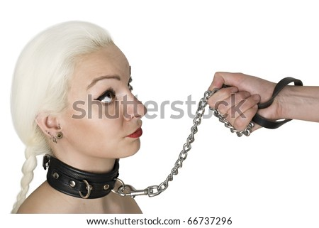 Sexy Blond woman with leather collar and leash holding by male's hand.