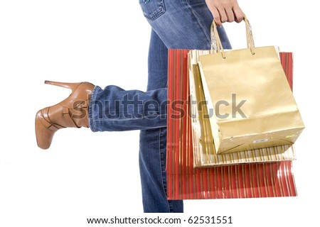 sexy blond woman with shopping bags smiling happily