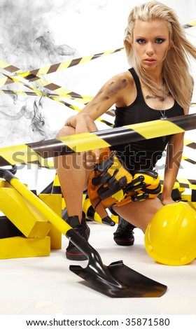 Sexy blonde female construction worker - stock photo