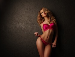 Sexy blonde girl with full lips posing underwear
