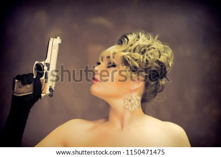 Stock Photo sexy blonde in black gloves with gun in hands