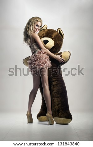 Sexy blonde with huge teddy bear