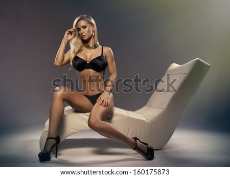 Sexy blonde woman sitting on a stylish leisure