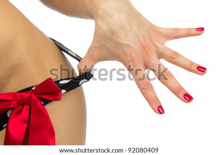 Sexy body of young beautiful caucasian woman taking off her sexy lingerie panties or thongs by hand with perfect manicure shellac on a white background