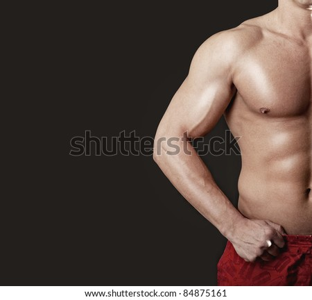 Sexy bodybuilder showing his muscular body