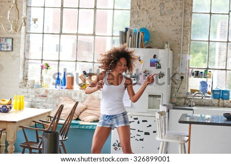 Shutterstock Sexy brazilian girl dancing at home wearing checked pajamas shorts throwing hair back