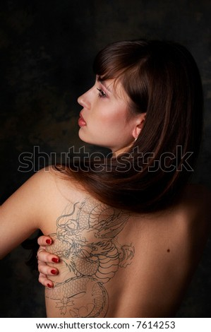 stock photo : Sexy brunette girl with dragon tattoo