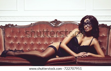 Sexy brunette in erotic lingerie. Woman in vintage interior.