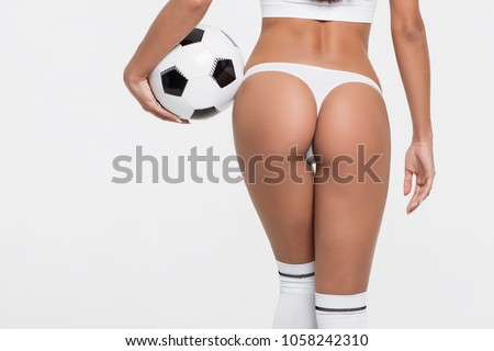 Sexy brunette with a soccer ball #1058242310