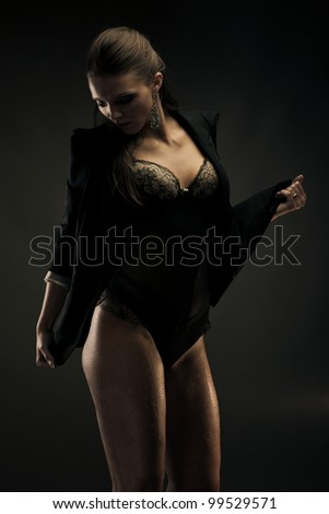 Sexy brunette woman wearing jacket and lingerie