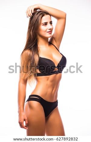 Sexy brunette woman wearing navy black swimwear posing on white background.