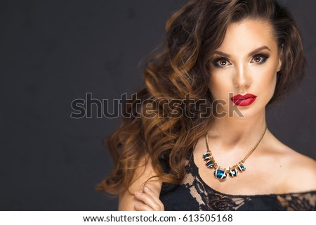 Sexy brunette woman with red lips