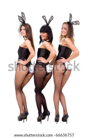 Sexy bunny girls posing against isolated white background