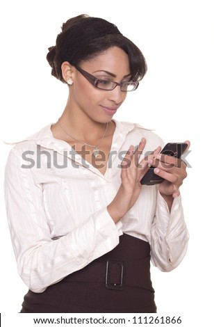 Sexy business professional smiles while using her phone.